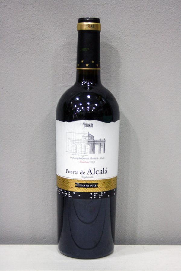 Vino Puerta de Alcala Reserva: es un vino tinto de Reserva 2013 elaborado a partir de la variedad Tempranillo (100%) por Vinos Jeromin, bajo la denominación de origen vinos de Madrid. Vino galardonado con diferentes premios · Floristería Los Santos Niños · Alcalá de Henares · Madrid