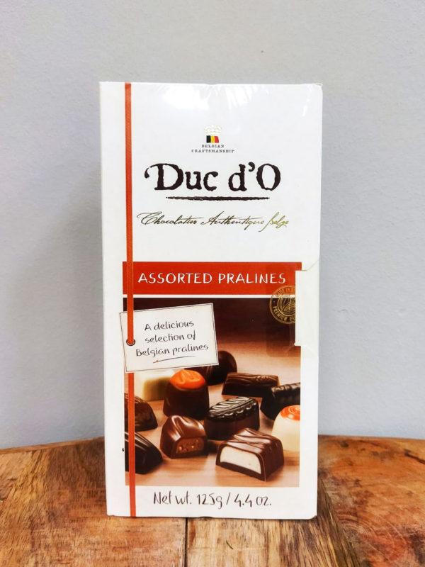 Caja de Bombones 125 gr. · Surtido de auténticos bombones de chocolate belga de alta calidad, una deliciosa selección de praliné belgas · Floristería Online Los Santos Niños · Alcalá de Henares · Madrid