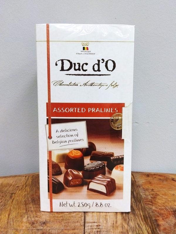 Caja de Bombones 250 gr. · Surtido de auténticos bombones de chocolate belga de alta calidad, una deliciosa selección de praliné belgas · Floristería Online Los Santos Niños · Alcalá de Henares · Madrid